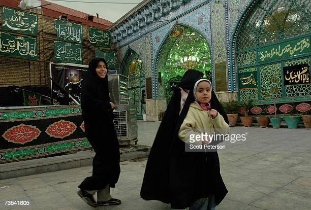 Girls walk past the shrine of Zaid ibn Ali as Iranian Shiite Muslims mark Arbaeen the 40th day after the death of Imam Hussein in 680 AD in the Grand...