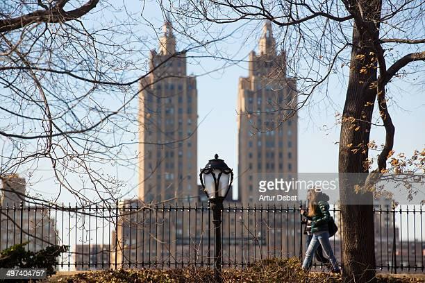 Girls walking in Central Park Onasis lake New York