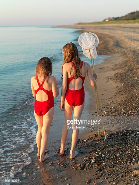girls walking on rocky beach - tween girls hot stock photos and pictures