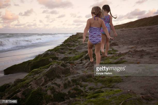 girls walking on sand dune, blowing rocks preserve, jupiter, florida, usa - blowing rocks preserve stock photos and pictures