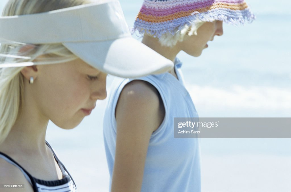 Girls walking on sandy beach, close up : Stock Photo