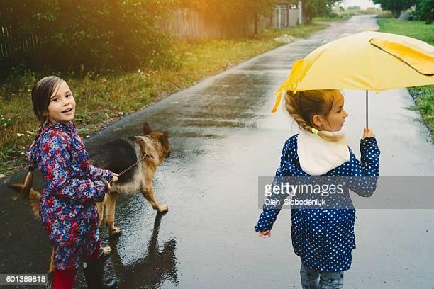 Girls walking with dog