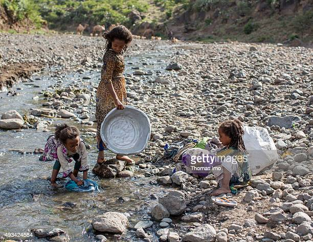 Girls washing clothes in a Creek on October 13 2015 in Mahoni Ethiopia