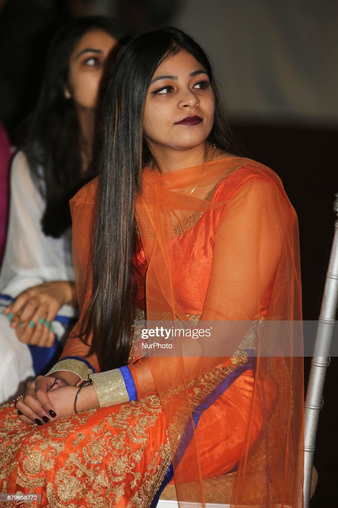 Girls watch a fashion show during the Diwali Gala Celebration held in Mississauga Ontario Canada on 25 November 2017 This luxurious gala event and...