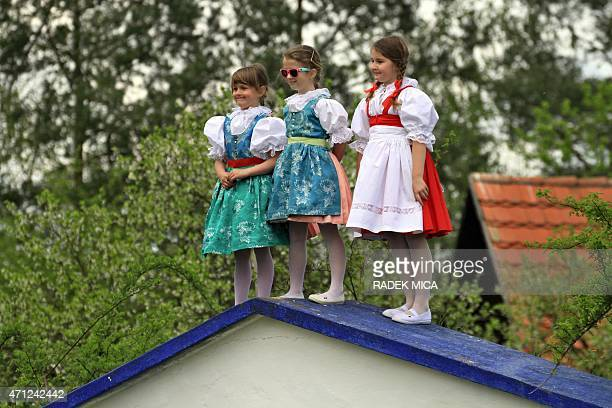 Girls watch from the roof of a wine cellar as the 20 meter tall maypole is erected in Straznice south Moravia 100 km southeast from Brno Czech...