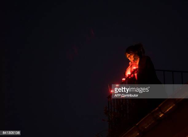 """Girls watches from a balcony of the """"August 31"""" street in the northern Spanish Basque city of San Sebastian on August 31 during the commemoration of..."""