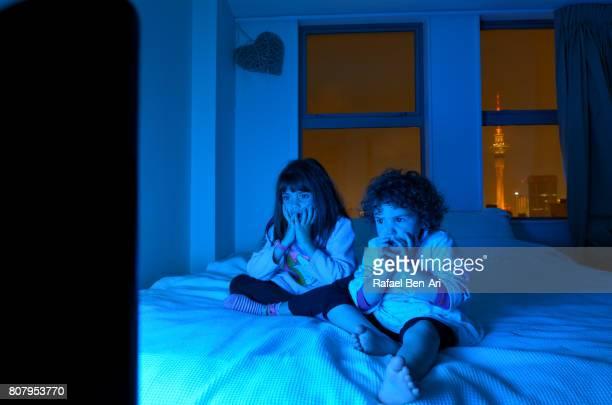 Girls watching a late night movie