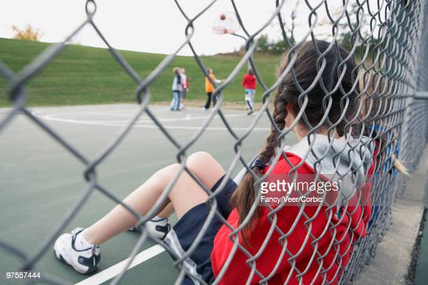 girls watching boys playing basketball - climat stock pictures, royalty-free photos & images