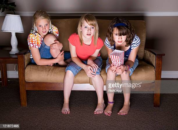girls watching movie - little girls bare feet stock photos and pictures
