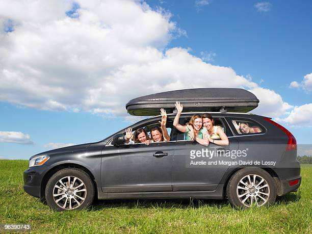 girls waving out of car windows
