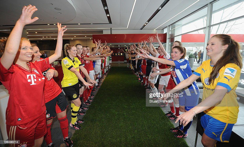 Girls wear the football kits of the 36 clubs in the first and second Bundesliga during the press conference to announce Hermes as the new DFL premium sponsor on January 14, 2013 in Hamburg, Germany.