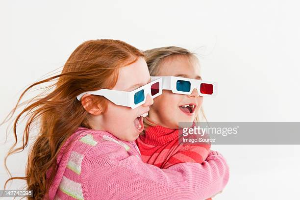 Girls wearing 3D glasses
