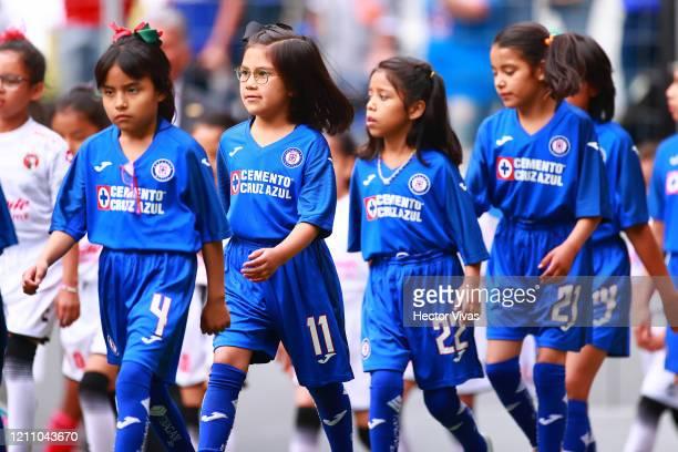 Girls wearing Cruz Azul uniforms enter the field during the 9th round match between Cruz Azul and Tijuana as part of the Torneo Clausura 2020 Liga MX...