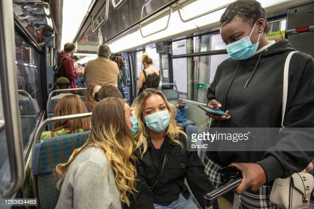 girls wearing face mask for protection at subway metro - crowd stock pictures, royalty-free photos & images