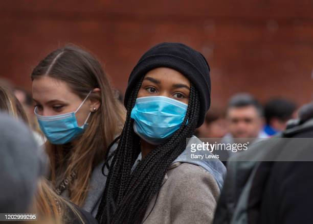 Girls wearing masks as protection against the Coronovirus during the Chinese New Year celebrations 26th January 2020 Chinatown London United Kingdom...