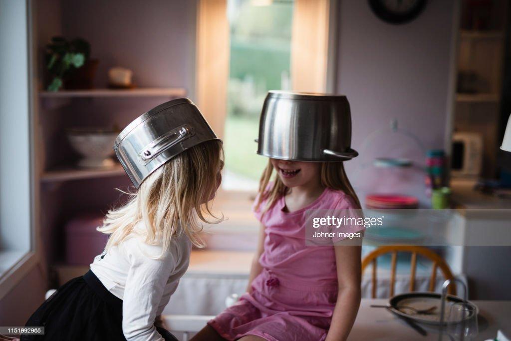 Girls wearing pots : Stock Photo