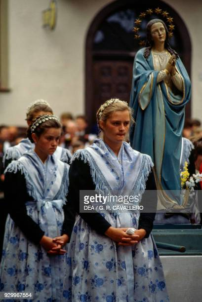 Girls wearing traditional clothes in a procession during the feast of Sarner Kirchtag Sarentino TrentinoAlto Adige Italy