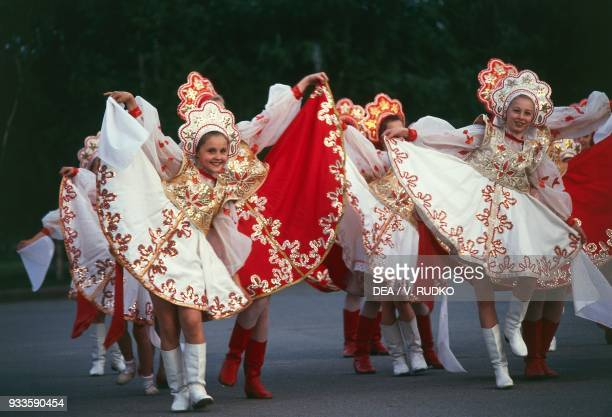 Girls wearing traditional costumes folk group Russia