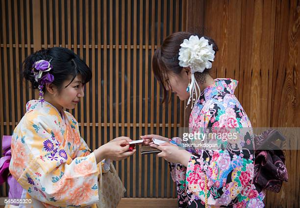 girls wearing traditional kimono costume  at street of kyoto tokyo
