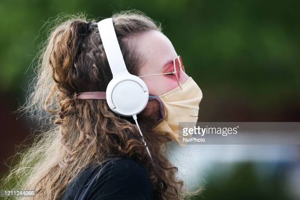 Girls wears a protective face mask due to the spread of coronavirus. Krakow, Poland on April 28, 2020. The rule of covering the nose and mouth in...