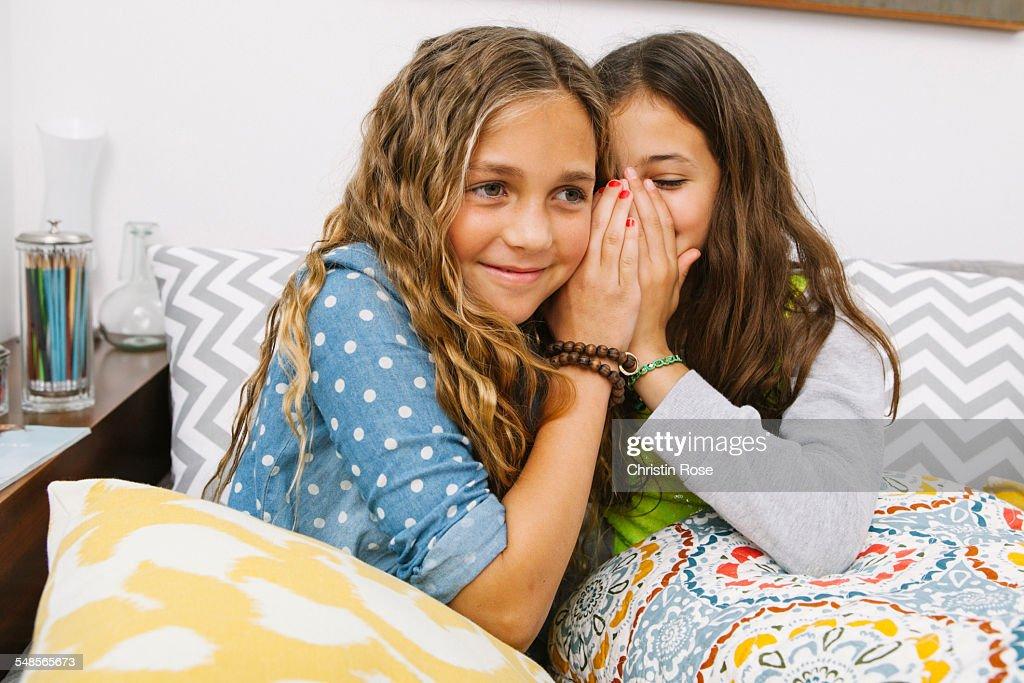 Girls whispering : Stock Photo