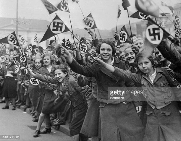 Girls who waited for hours on Wilhem Platz Berlin to greet Hitler as leader of the united German Nation Thousands lined streets