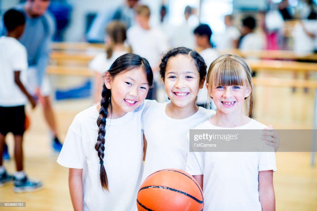 Girls With Basketball : Stock Photo