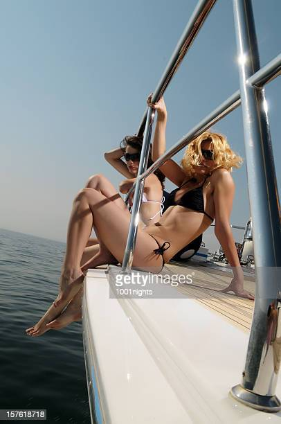girls with bikini on the yacht - yachting stock pictures, royalty-free photos & images