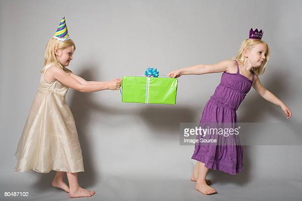 girls with birthday present - happy birthday images for sister stock pictures, royalty-free photos & images