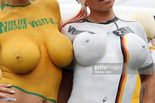 Girls with body painted football jerseys of Germany and Australia pose during a sexy soccer match between VisitX Camgirls and Blue Movie All Stars at...