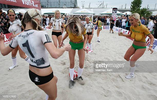 Girls with body painted football jerseys of Germany and Australia in action during a sexy soccer match between VisitX Camgirls and Blue Movie All...