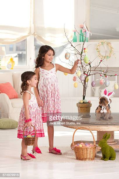 girls with easter tree - dog easter stock pictures, royalty-free photos & images