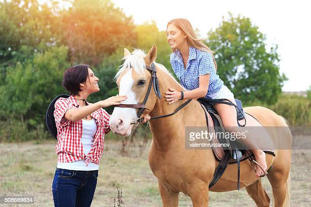 Girls with horse in nature