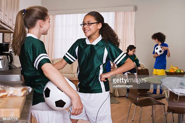 girls with soccer ball at home - soccer uniform stock pictures, royalty-free photos & images