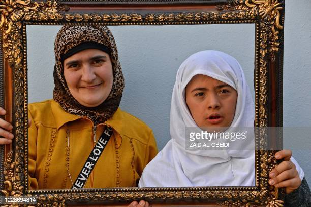 Girls with special needs pose for a picture at the Fakhri Dabbagh Centre in the eastern side of Iraq's northern city of Mosul on February 25, 2020. -...