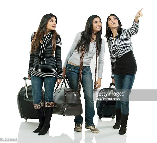 Girls with suitcases