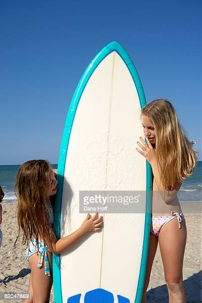 Girls with surfboard