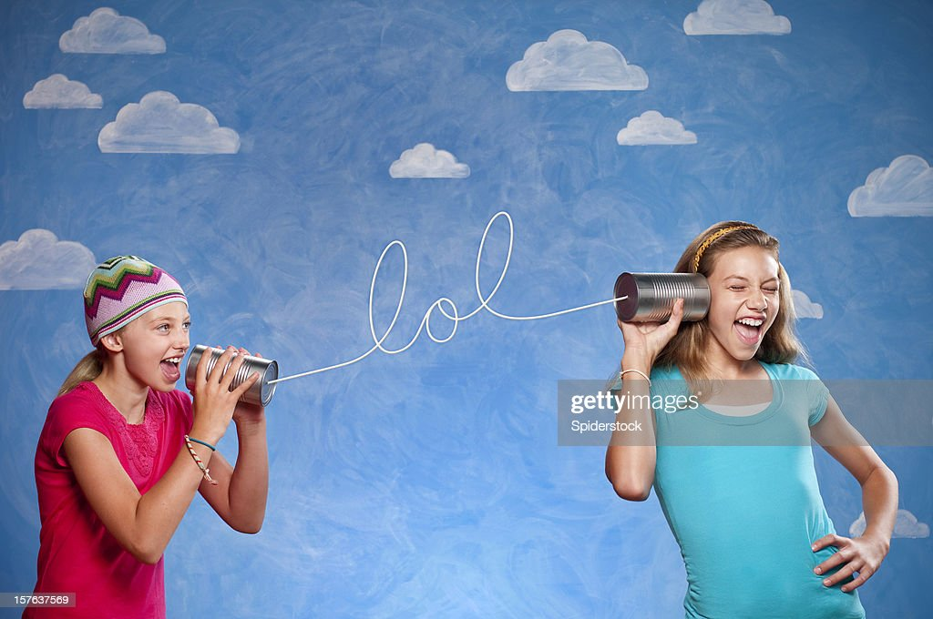 Girls With Tin Can Telephones : Stock Photo