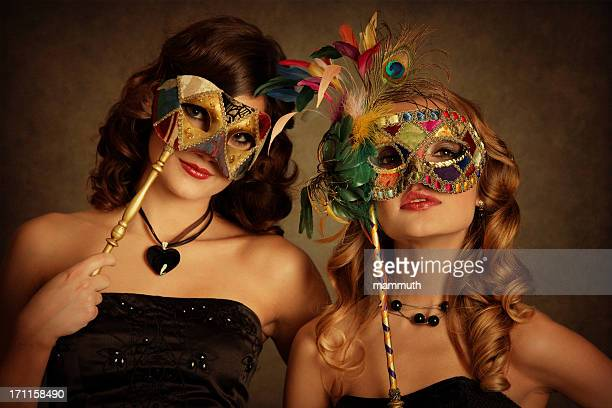girls with venetian mask - mardi gras party stock photos and pictures
