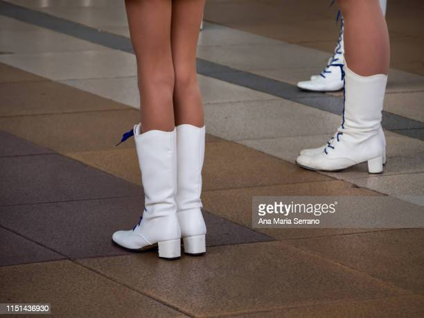 girls with white boots in a majorettes performance in salamanca - drum majorette stock pictures, royalty-free photos & images