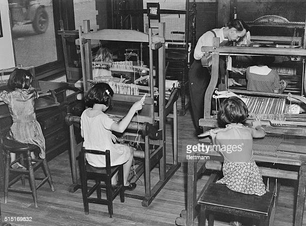 Girls working at looms at Hull house in Chicago Ill which was founded by Jane Addams