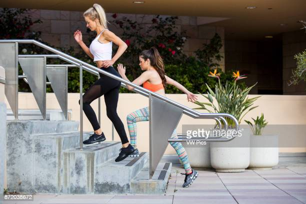 Girls workout and stretch together in a beautiful outdoor and urban setting