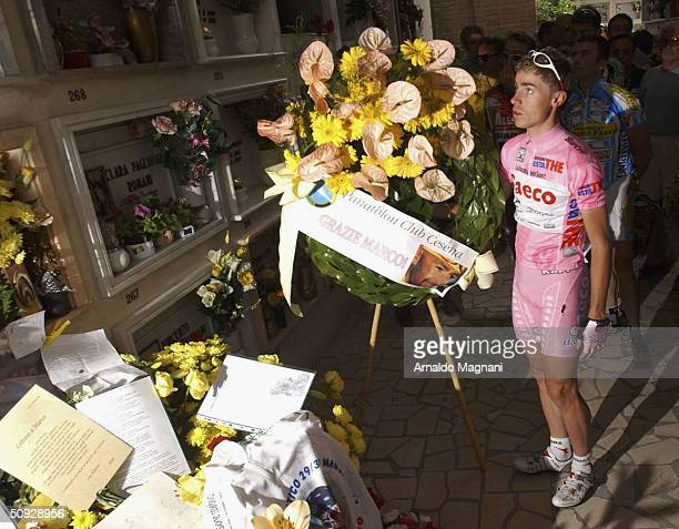 Giro D'Italia winner Damiano Cunego visits a memorial to cyclist Marco Pantani is seen June 5, 2004 in Cesenatico, Italy. Pantani died February 14,...