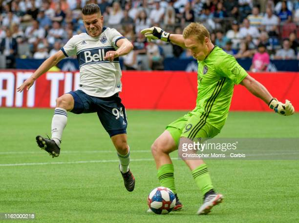 Giro of Vancouver Whitecaps tries to block a kick by goalkeeper Tim Melia of Sporting Kansas City at BC Place on July 13 2019 in Vancouver Canada