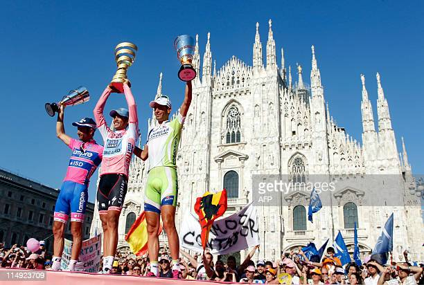 Giro winner Spanish Alberto Contador , second place Michele Scarponi and third place Vincenzo Nibali stand on the podium of the 94th Tour of Italy ,...