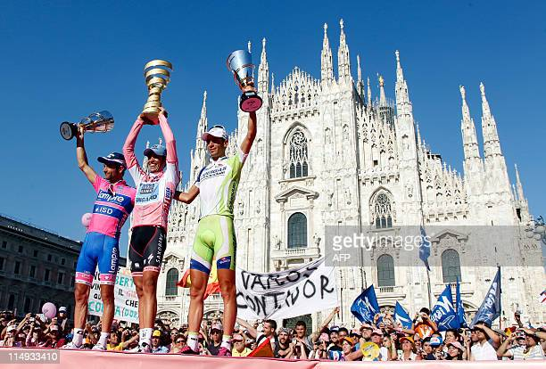 Giro winner Spanish Alberto Contador second place Michele Scarponi and third place Vincenzo Nibali stand on the podium of the 94th Tour of Italy run...