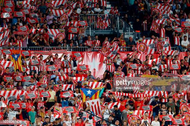 Girona fans cheer during the Spanish league football match between Girona FC and Real Madrid CF at the Montilivi stadium in Girona on August 26 2018