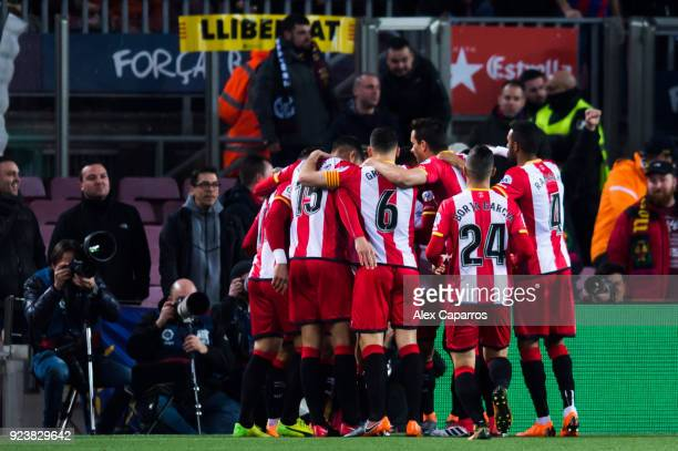 Girona FC players celebrate after their teammate Cristian 'Portu' scored the opening goal during the La Liga match between Barcelona and Girona at...