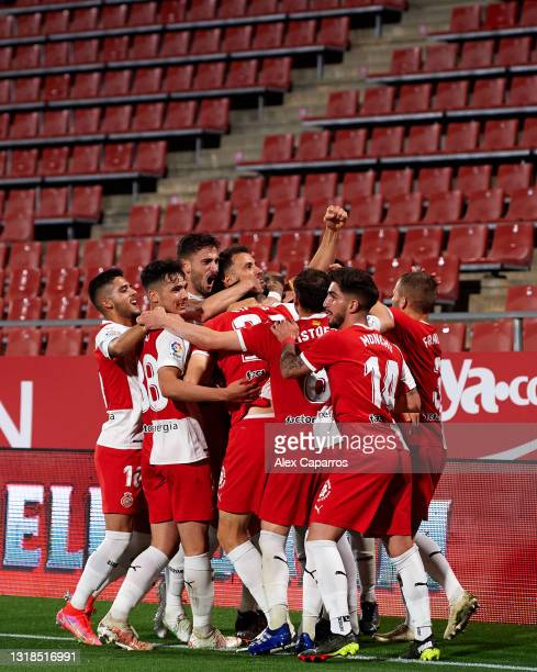Girona FC players celebrate their team's first goal scored by Juan Pedro 'Juanpe' Ramirez during the Liga Smartbank match betwen Girona FC and Real...