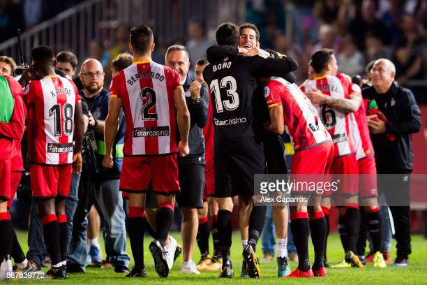 Girona FC players celebrate their victory after the La Liga match between Girona and Real Madrid at Estadi de Montilivi on October 29 2017 in Girona...